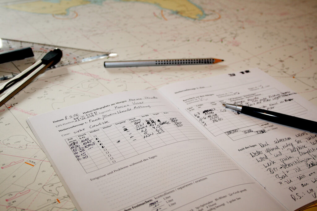 Traditional paperback marine logbook with entries, updated roughly every half hour.
